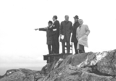 Walter on summit of Jay Peak, pointing out his vision of the area to Weyerhaeuser officials in 1965